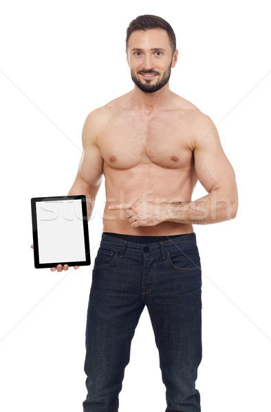 Muscular man pointing to a digital tablet Stock photo © goir