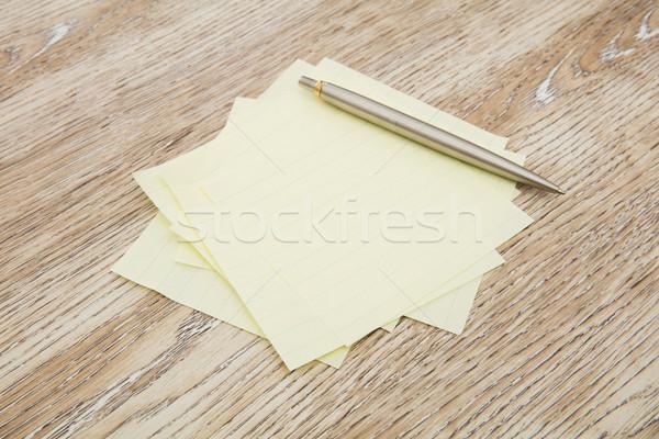 Zelfklevend nota bureau houten potlood teken Stockfoto © goir