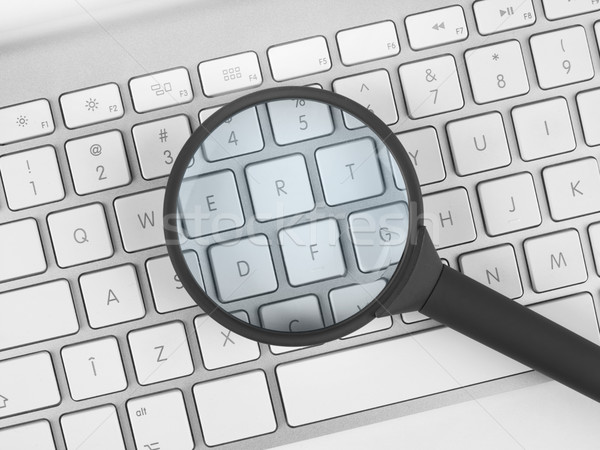 Magnifying glass over a keyboard Stock photo © goir