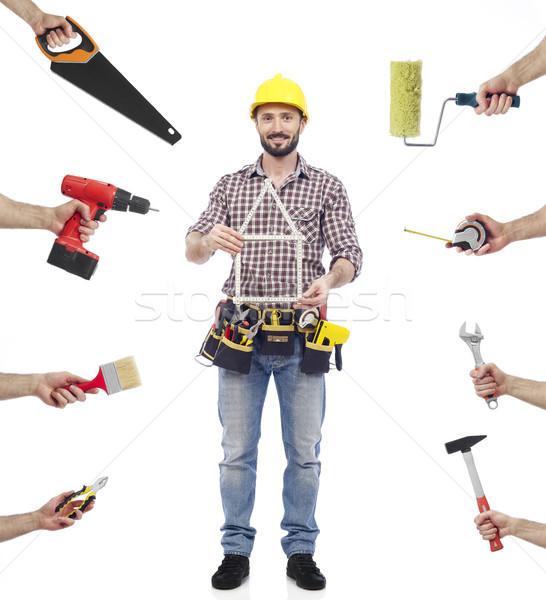 Multitâche charpentier regarder caméra Photo stock © goir