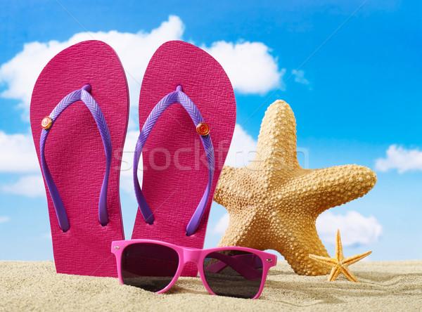 Flip-flops, starfish and sunglasses Stock photo © goir