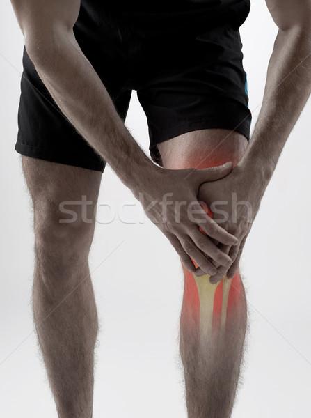 Knie pijn man holding handen mannen Rood Stockfoto © goir
