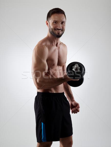 Vrolijk man gespierd gewichten geïsoleerd Stockfoto © goir