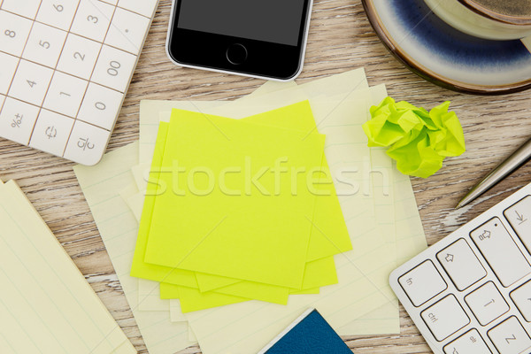 Adhesive note on messy desk Stock photo © goir