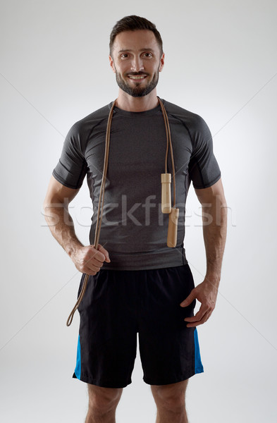 Trainer with jump rope Stock photo © goir