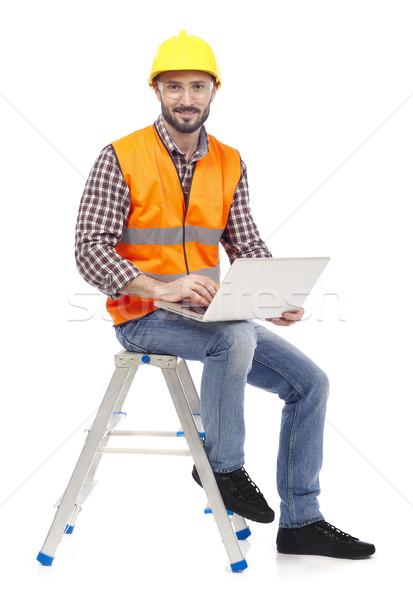Charpentier portable séance échelle travail blanche Photo stock © goir