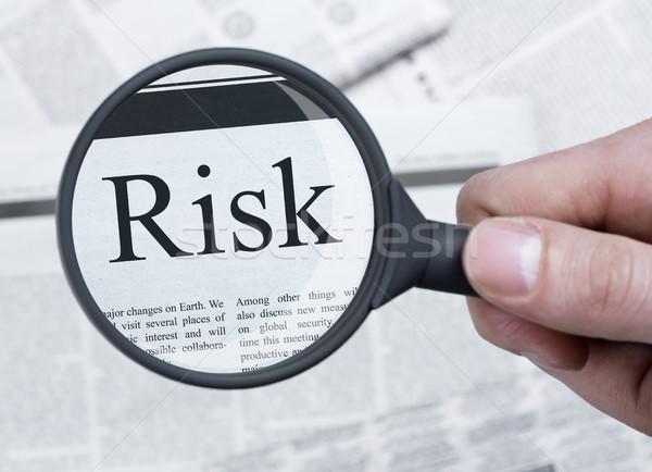 Risk under magnifying glass Stock photo © goir