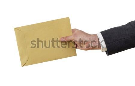 Postás boríték tart citromsárga posta öltöny Stock fotó © goir