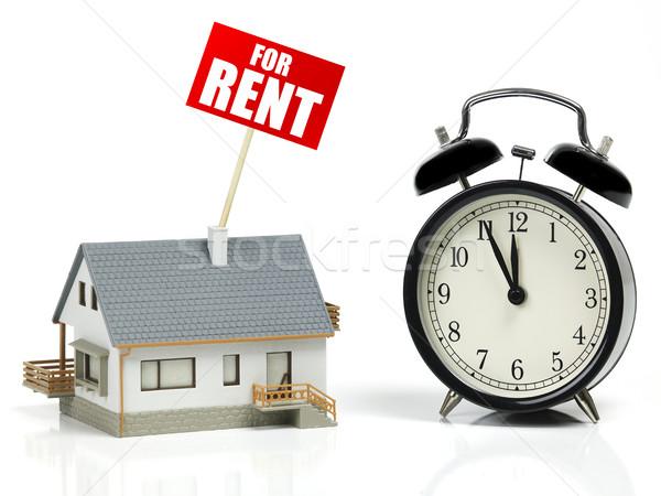 Modèle maison louer signe horloge blanche Photo stock © goir