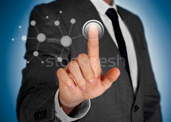 Man touching a virtual network screen Stock photo © goir