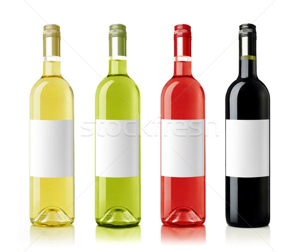 Vin bouteilles étiquettes Rose Red vert bouteille de vin blanc Photo stock © goir