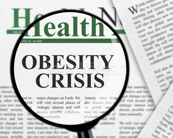 Obesidad crisis titular lupa papel periódico Foto stock © goir