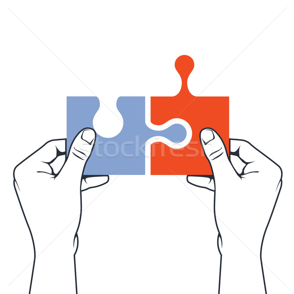 Hands joining puzzle piece - association and merger concept Stock photo © gomixer