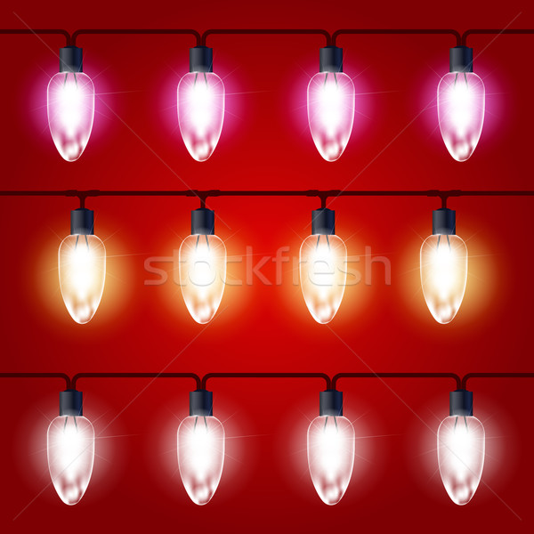 Christmas Lights - festive luminous garland with light bulbs Stock photo © gomixer