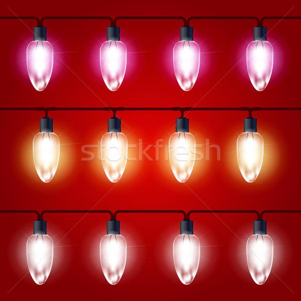 Stock photo: Christmas Lights - festive luminous garland with light bulbs