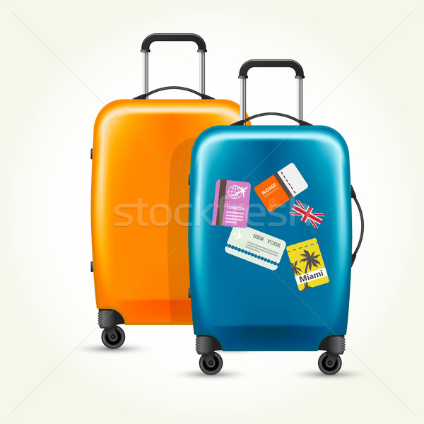Plastic wheeled suitcases - baggage with travel tags Stock photo © gomixer