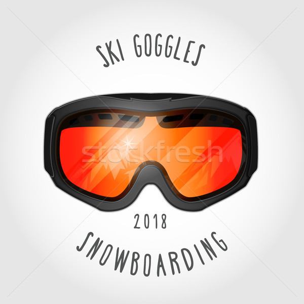 Snowboard or ski goggles with reflection of mountains Stock photo © gomixer