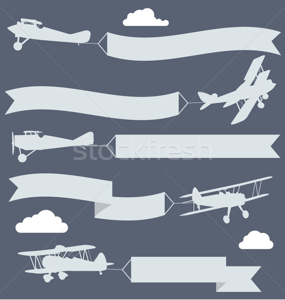Silhouettes of biplanes with wavy greetings banner Stock photo © gomixer