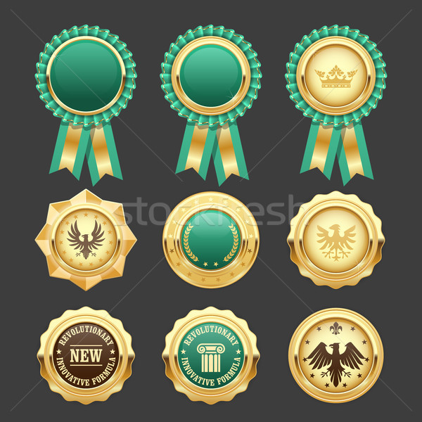 Green award rosettes and gold medals - prize insignia Stock photo © gomixer