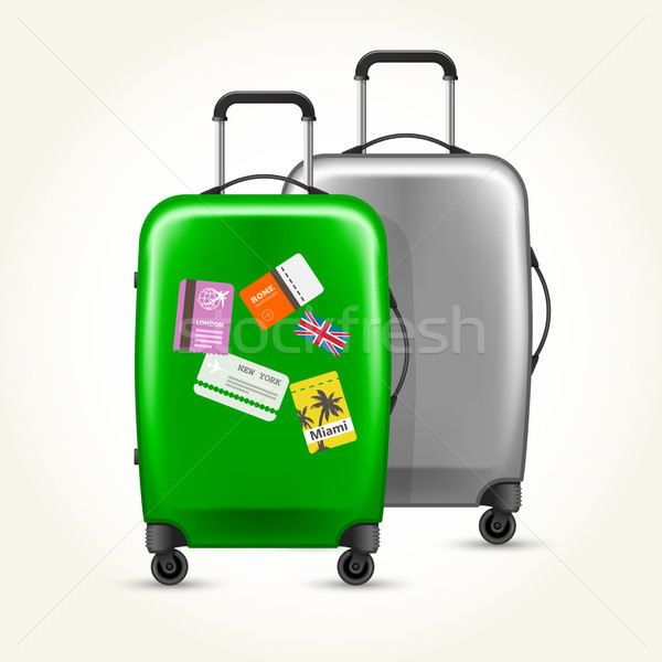 Wheeled suitcases with travel tags - silver and green baggage Stock photo © gomixer