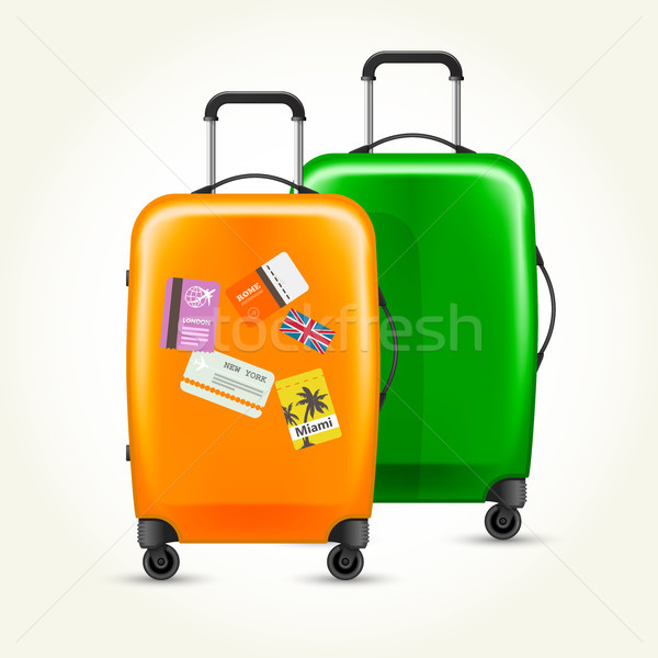 Modern plastic wheeled suitcases with travel tags Stock photo © gomixer