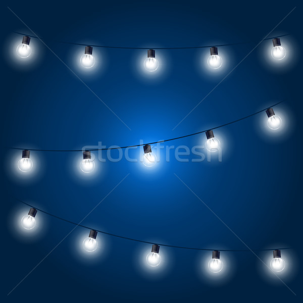 Christmas Lights - festive light bulbs garland on blue Stock photo © gomixer