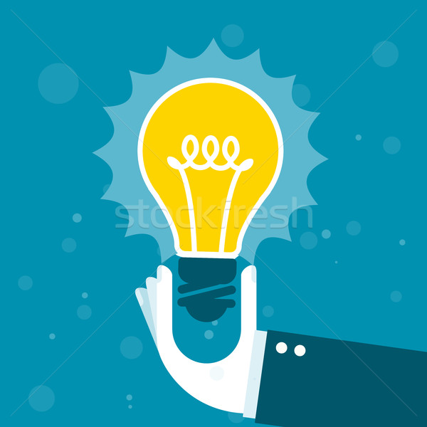 Innovation - hand holds shining light bulb Stock photo © gomixer