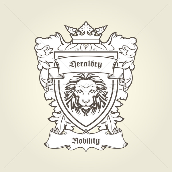 Heraldic emblem - coat of arms with head of lion on shield with  Stock photo © gomixer