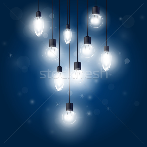 Luminous light bulbs hanging on cords - lamps Stock photo © gomixer