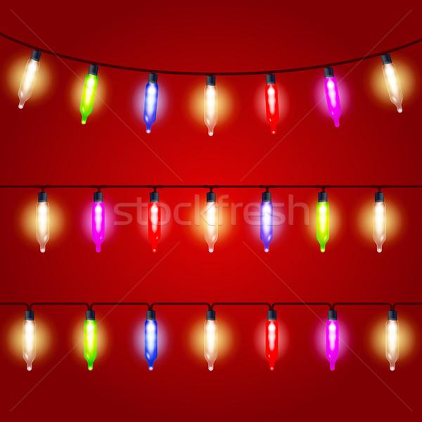 Natal luzes carnaval elétrico luz vermelho Foto stock © gomixer