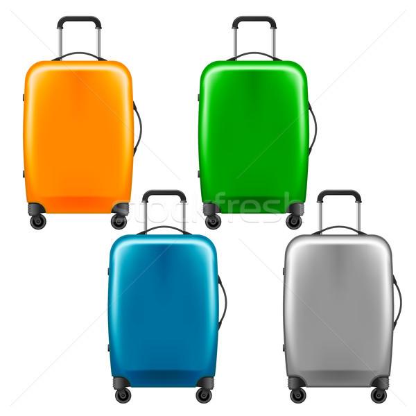 Nowoczesne plastikowe walizkę zestaw bagaż niebieski Zdjęcia stock © gomixer