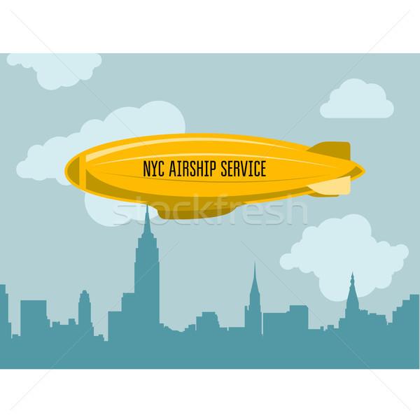 Dirigible over city - zeppelin with advertising message in cloud Stock photo © gomixer