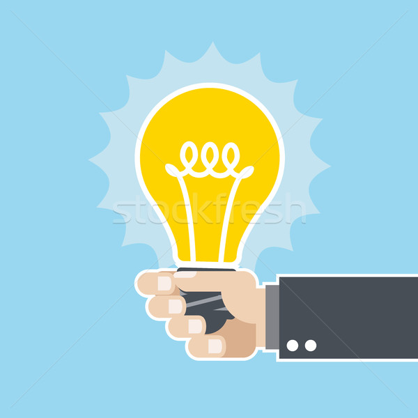Innovatív ötlet ragyogó villanykörte kéz Stock fotó © gomixer
