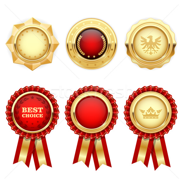 Red award rosettes and gold heraldic medals and insignia Stock photo © gomixer