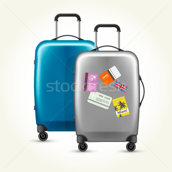 Wheeled plastic suitcases with baggage travel tags on white Stock photo © gomixer