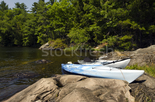 Kayaks on the Rocky Shoreline Stock photo © Gordo25