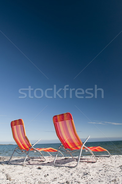 Beach Chairs on Lake Shoreline Stock photo © Gordo25