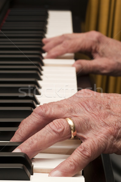Old Hands on the Piano Stock photo © Gordo25