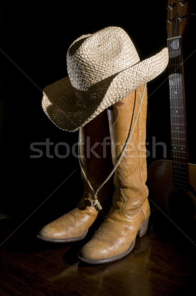 Spotlight bottes de cowboy guitare acoustique Cowboy chapeau pays Photo stock © Gordo25