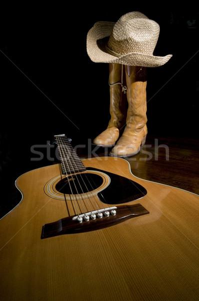 Guitarra botas de vaqueiros holofote primeiro plano foco madeira Foto stock © Gordo25