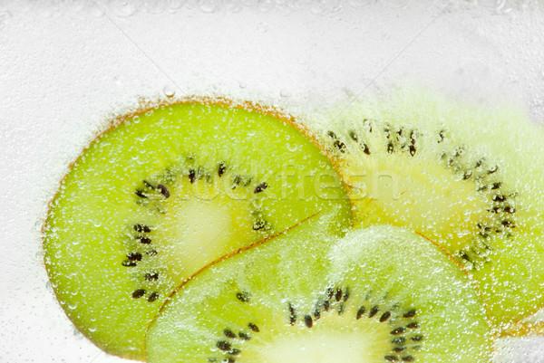 Pezsgő frissítő zöld szeletek kiwi frissítő Stock fotó © gorgev