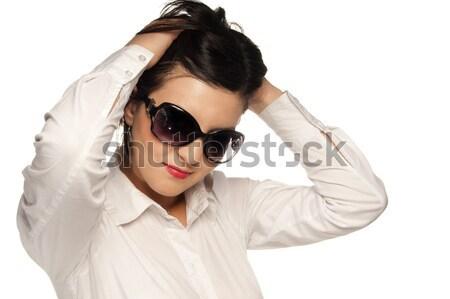 Lezser néz lány fehér póló napszemüveg Stock fotó © gorgev