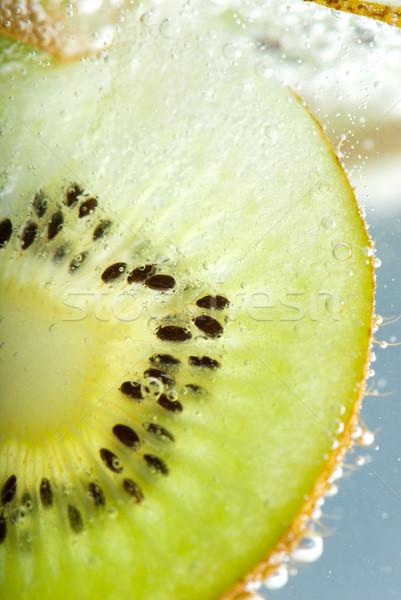Kiwi dipped in sparkling water Stock photo © gorgev