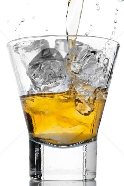 Whiskey and ice on white Stock photo © gorgev