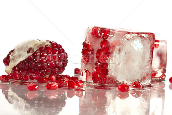 Pomegranate in ice Stock photo © Goruppa