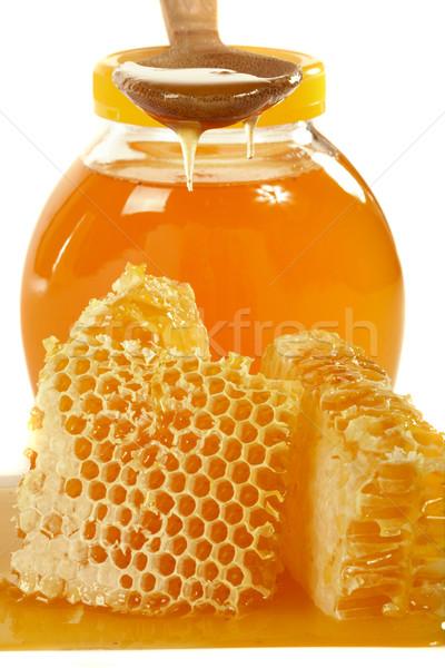 Miele a nido d'ape naturale alimentare vetro medicina Foto d'archivio © Goruppa
