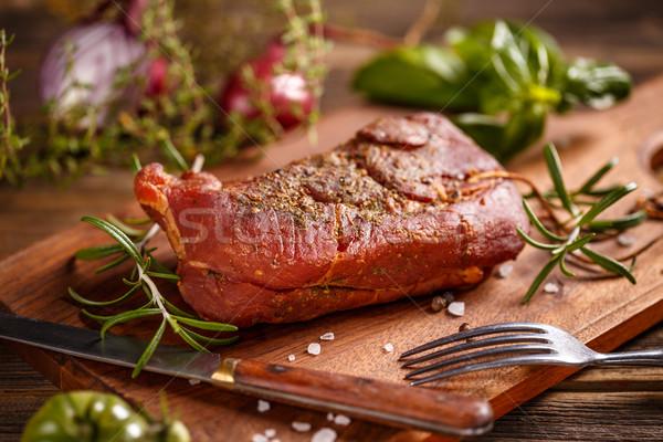 Füstölt disznóhús hús fából készült vágódeszka piros Stock fotó © grafvision