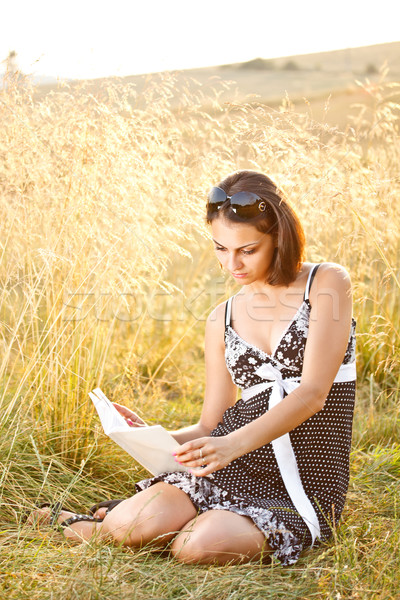 Сток-фото: читать · книга · сидят · трава · счастливым