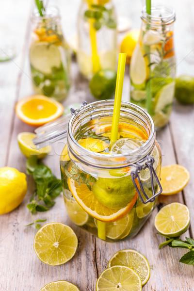 Citrom víz friss citromok menta levelek Stock fotó © grafvision