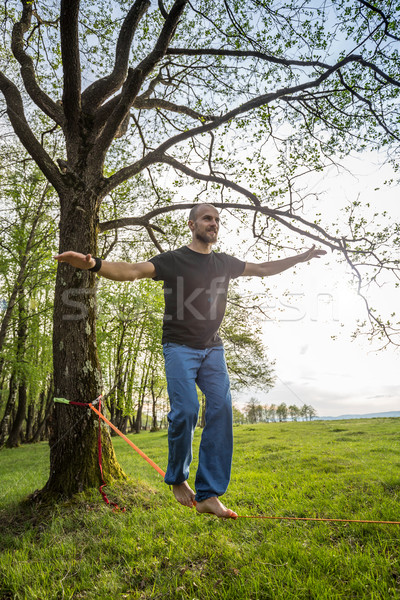 Young man slacklining  Stock photo © grafvision